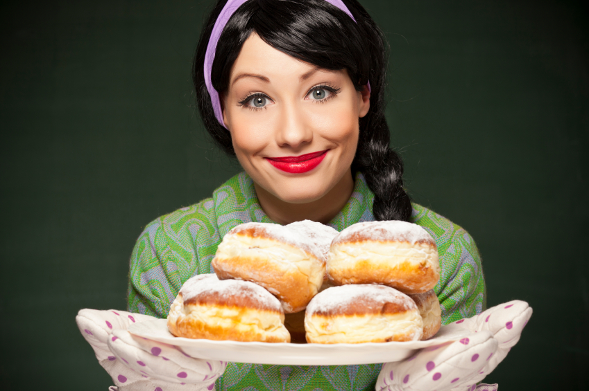 Retro housewife with freshly baked donuts