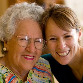 Smiling Grandmother and Adult Granddaughter
