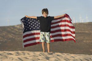 Boy with the American Flag on a Beach