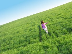 Girl running free in field
