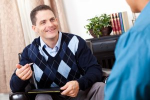 Happy counselor talking to client