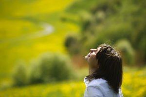 A woman enjoying the green countryside