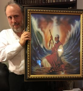 The author with a portrait of Moses.