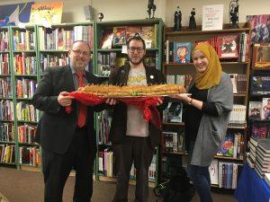 Rabbi Jack Abramowitz, Menachem Luchins and G. Willow Wilson with the sandwich