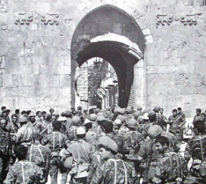 Soldiers approach the Old City walls in 1967