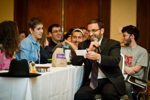 Rabbi Yaakov Glasser teaching teens at NCSY's Yarchei Kallah program.