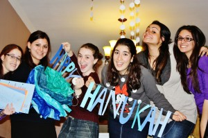 Queens College students celebrating Chanukah. (Shoshana Charnoff)