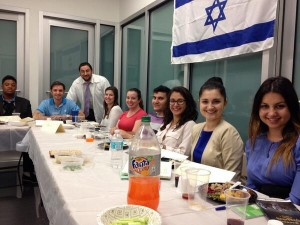 Southern NCSY's Rabbi Ben Gonsher (in the kittel) led a seder for students at St. Thomas University School of Law.