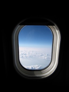 Airplane window view -- clouds, sky