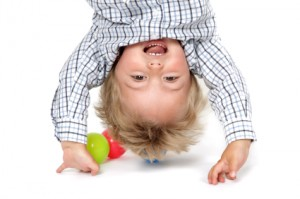 kid hanging upside down